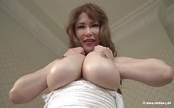 Anri Okita playing with her boobs